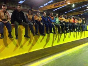 Workers on beam